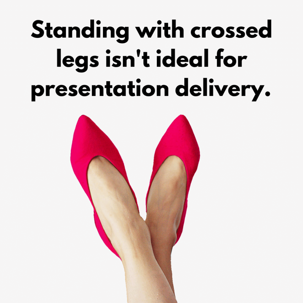 standing with legs crossed while presenting